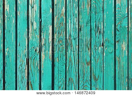 Old shabby wooden planks with cracked paint. Retro wall background.