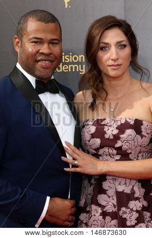 LOS ANGELES - SEP 11:  Jordan Peele, Chelsea Peretti at the 2016 Primetime Creative Emmy Awards - Day 2 - Arrivals at the Microsoft Theater on September 11, 2016 in Los Angeles, CA