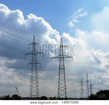 High voltage power lines 110 kV on cloudy evening sky background