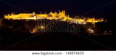 Yellow Carcassonne City At Night Lighted Up In France