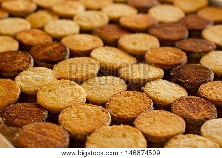 Rows of cookies. Brown and yellow biscuits. Production of desserts. Only top quality components.