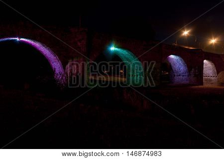 Coloured Lights In The Old Bridge In Carcassonne, France