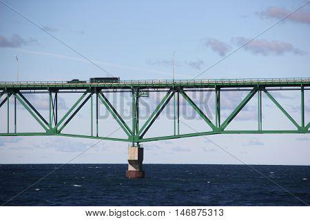 A truck drives across the Mackinac Bridge, Michigan