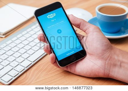 CHIANG MAI, THAILAND - Apr 12,2016: Hand of man holding a Apple iPhone Skype showing on screen. Skype is an application that providing text chat, video chat and voice calls