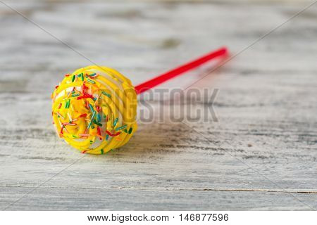Cake lollipop with icing. Bright-colored sprinkles. Easy recipe of great mood. Candy with sponge cake filling.