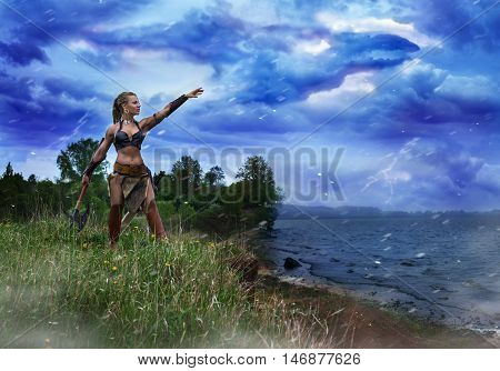 Athletic female in the image of the ancient Princess of the barbarians performing a magical ritual invocation of the spirit of the storm.