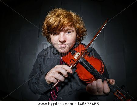 Freckled Red-hair Boy Playing Violin