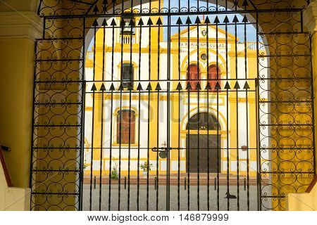 View of the Church of the Immaculate Conception as seen through a gate in Mompox Colombia