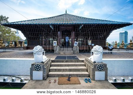 COLOMBO SRI LANKA - FEBRUARY 16 2016: The Seema Malaka Temple in Colombo is situated on Beira Lake and is part of the Gangaramaya Buddhist Temple Complex.