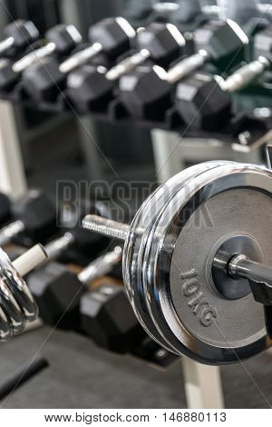 Dumbbells in a gym, sport concept