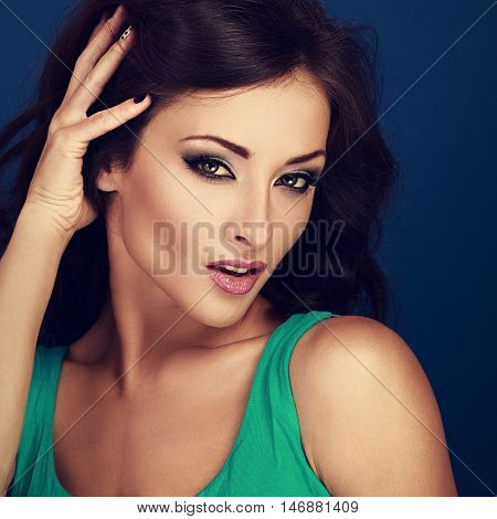 Sexy Bright Makeup Woman With Pink Lipstick Touching Her Long Brown Curly Hair Manicured Fingers. To