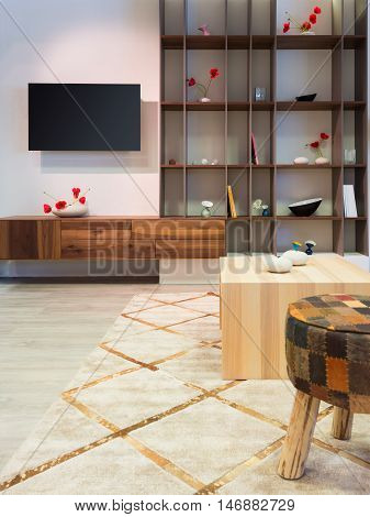 modern wood living room furniture with shelf and flat tv at wall