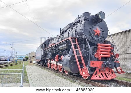 RTISHCHVO RUSSIA - September 08.2016: Monuments old steam locomotive. Gift of the local railroaders station Rtishchevo