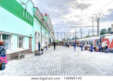 SARATOV RUSSIA - September 09.2016: Passengers expect the landing beginning in a train on the platform of the municipal railway station