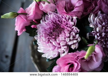 Bouquet of pink flowers closeup, eustoma and chrysanthemum, elegant vintage floral decor