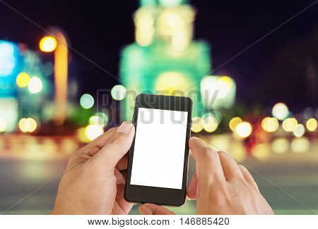 Women using Smart Phone on the night street with light bokeh background vintage style for design