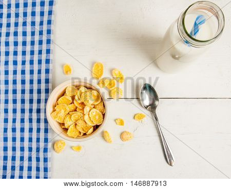 Light healthy breakfast: cornflakes and milk for them. Top view