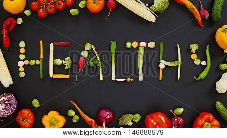 Vegetables made word healthy. vegetables made of word healthy. vegetables on a black background. Word healthy on a black background.
