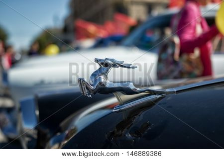 Distinguishing Sign On The Hood Of A Retro Car Volga Gaz-21 In The Form Of A Running Deer