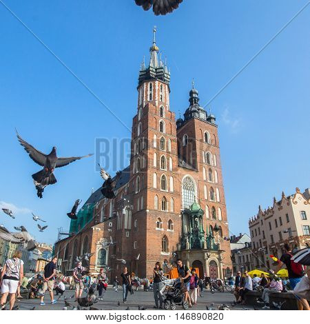 KRAKOW, POLAND - SEP 7, 2016: Main Market Square, is the principal urban space located at center of city. Krakow is visited by over 8 mln tourists a year, number of foreign tourists up to 2 mln people