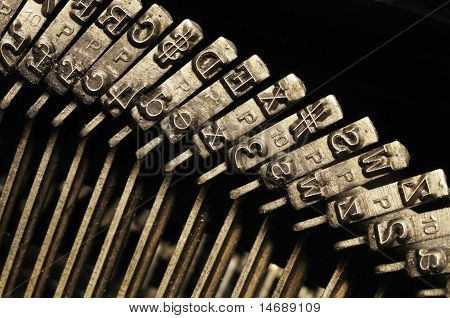 Close-up Of Old Typewriter Letter And Symbol Keys