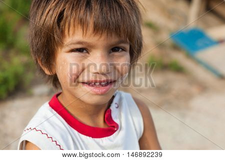 ZAGREB, CROATIA - OCTOBER 21, 2013: Portrait of cute little Roma boy.