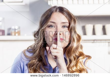 young blonde girl does sign to be silent