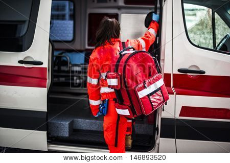 girl emergency volunteer operator with emergency rucksack in an ambulance