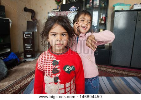 ZAGREB, CROATIA - OCTOBER 21, 2013: Portrait of little Roma girls at their home.