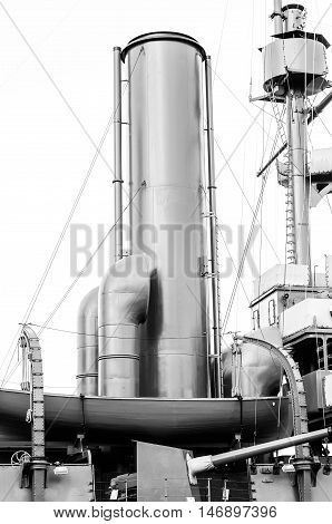 Chimneys of the old armored cruiser. Black and white photo