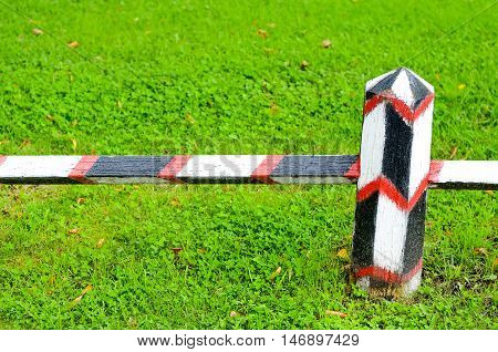 Wooden border fence background of green grass.