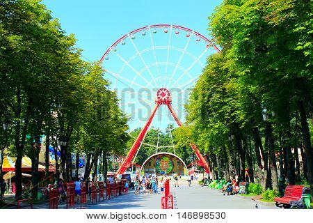 Kharkiv / Ukraine. 07 August 2016: view to ferris wheel and people walk in Gorky park in Kharkiv. 07 August 2016 in Kharkiv / Ukraine.