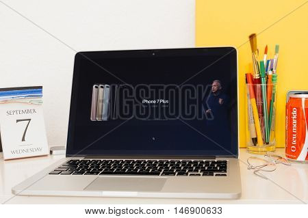 PARIS FRANCE - SEP 8 2016: Apple Computers website on MacBook Retina in room environment showcasing live coverage of Apple Keynote - iPhone and iPhone 7 plus prices and availability and upgrade - all Phone 7 range