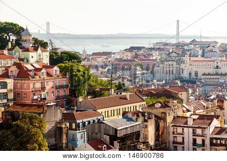 Aerial view of Lisbon Portugal during the day. Bridge at the background