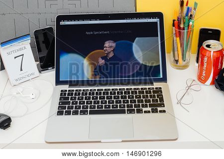 PARIS FRANCE - SEP 8 2016: Apple Computers website on MacBook Retina in room environment showcasing live coverage of Apple Keynote - Tim Cooke welcoming guests