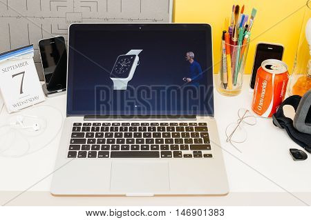 PARIS FRANCE - SEP 8 2016: Apple Computers website on MacBook Retina in room environment showcasing live coverage of Apple Keynote - introducing ceramic Apple Watch