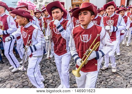 Antigua Guatemala - September 15 2015: Trumpet players march in street parade during Guatemalan Independence Day celebrations