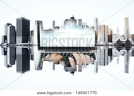 Abstract image of hands using laptop with business chart on abstract upside down city background. Double exposure. Fund management concept