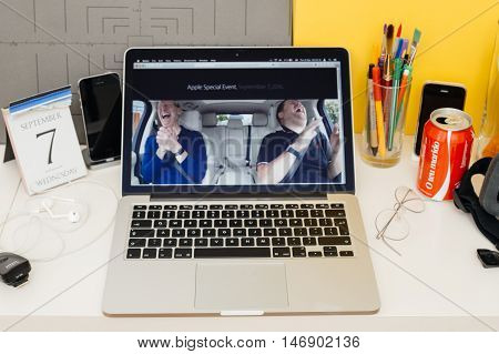 PARIS FRANCE - SEP 8 2016: Apple Computers website on MacBook Retina in room environment showcasing live coverage of Apple Keynote - CEO Tim Cook singing with James Corden in a Carpool Karaoke type video