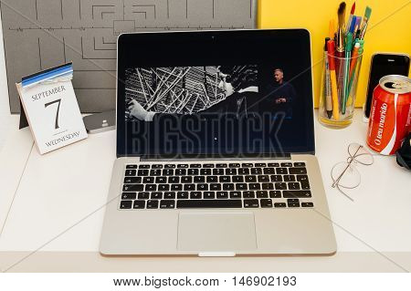 PARIS FRANCE - SEP 8 2016: Apple Computers website on MacBook Retina in room environment showcasing live coverage of Apple Keynote - lighting connection new earbuds headphones