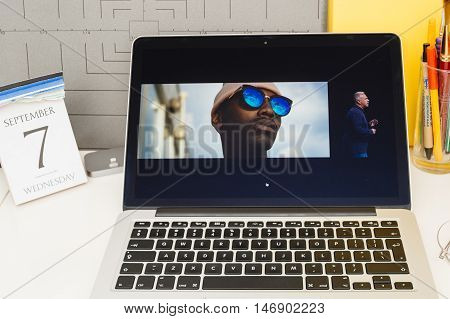 PARIS FRANCE - SEP 8 2016: Apple Computers website on MacBook Retina in room environment showcasing live coverage of Apple Keynote - presentation of iPhone new photo camera double camera