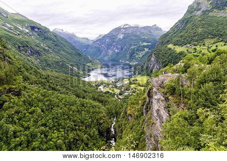 The end of Geiranger Fjord in Norway. The Geiranger is a fjord 15-kilometre (9.3 mi) long and is one of Norway's most visited tourist sites. In 2005, it was listed as a UNESCO World Heritage Site.