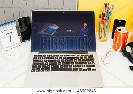 PARIS FRANCE - SEP 8 2016: Apple Computers website on MacBook Retina in room environment showcasing live coverage of Apple Keynote - Apple Watch with 50 faster dual core processor