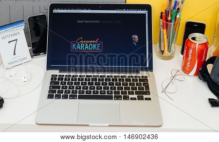 PARIS FRANCE - SEP 8 2016: Apple Computers website on MacBook Retina in room environment showcasing live coverage of Apple Keynote - Carpool Karaoke logo and Tim Cooke on stage
