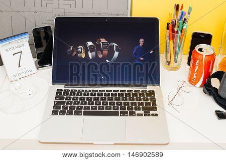 PARIS FRANCE - SEP 8 2016: Apple Computers website on MacBook Retina in room environment showcasing live coverage of Apple Keynote - full range of Apple Watch on stage