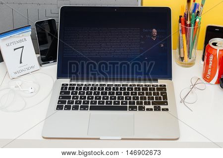 PARIS FRANCE - SEP 8 2016: Apple Computers website on MacBook Retina in room environment showcasing live coverage of Apple Keynote - Tim Cook about schools using Apple Coding