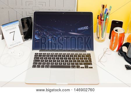 PARIS FRANCE - SEP 8 2016: Apple Computers website on MacBook Retina in room environment showcasing live coverage of Apple Keynote - Tiim Coo talking about 1 billion iPhone soldk