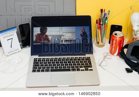 PARIS FRANCE - SEP 8 2016: Apple Computers website on MacBook Retina in room environment showcasing live coverage of Apple Keynote - TIm Cook-Apple will donate iMacs and Tablets to teachers and pupils