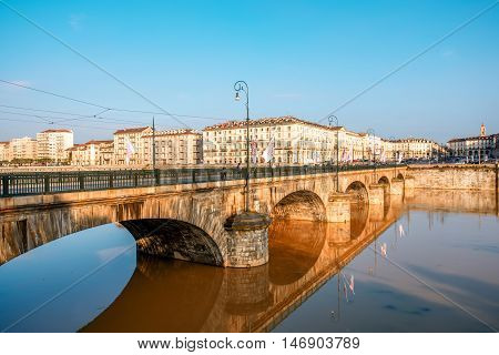 Turin, Italy - June 10, 2016: Vittorio Emanuele bridge with riverside on Po river in Turin old town in Piedmont region in Italy