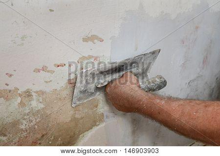 Worker Fix Damaged Wall